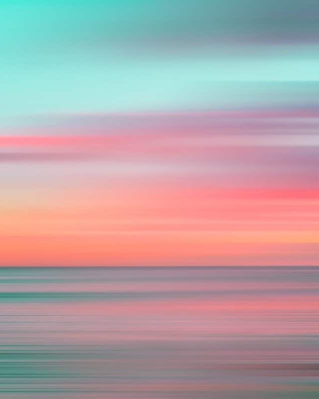 spectacular sunset photo of light blue, red, orange, green and yellow colors